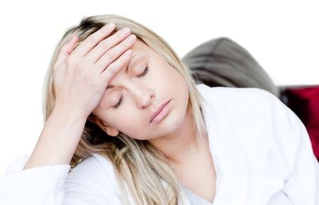 tiring: Tiring woman sitting on a sofa