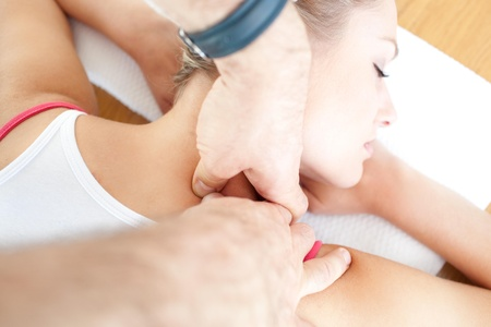 Relaxed woman having a massage photo