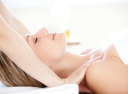 back massage: Charming woman receiving a back massage Stock Photo
