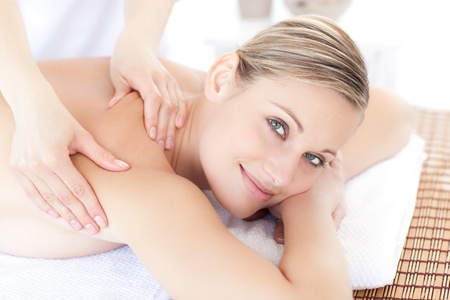 back massage: Smiling woman receiving a back massage