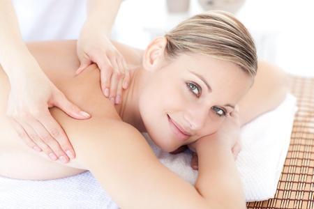 woman massage: Smiling woman receiving a back massage