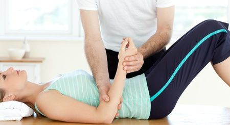 physical pressure: Attractive young woman receiving a massage