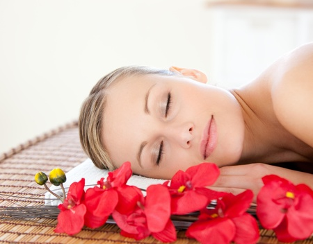 Beautiful woman relaxing in a Spa center photo