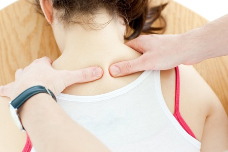 Close-up of a brunette woman receiving a back massage Stock Photo - 10096462
