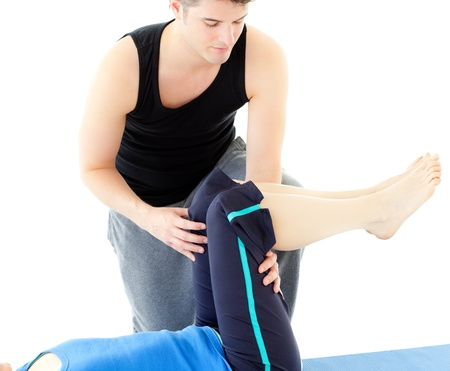 Caucasian woman exercising assisted by her personal trainer Stock Photo - 10094035