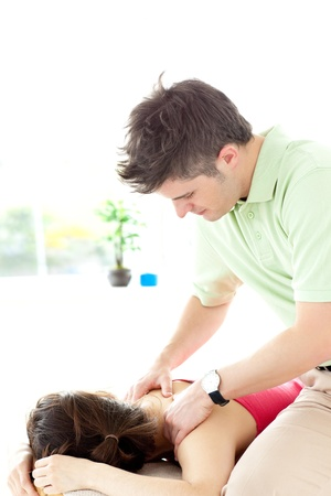 Young man giving a back massage Stock Photo - 10096414
