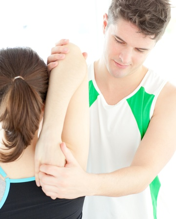 acupressure hands: Young physical therapist checking a womans shoulder