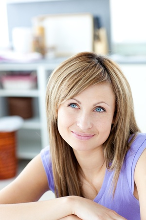 gratified: Attractive woman thinking  in the kitchen  Stock Photo