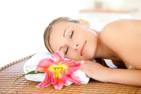 Portrait of a cute woman having a massage  photo