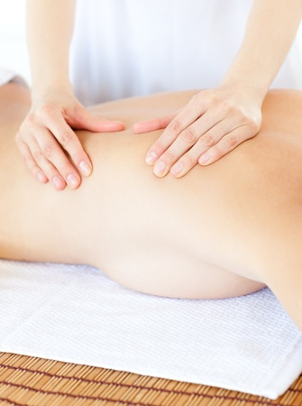 delighted: Delighted woman having a massage with massage oil