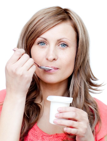 Attractive woman eating a yogurt  photo