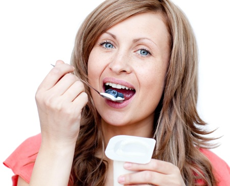 eating yogurt: Happy woman eating a yogurt