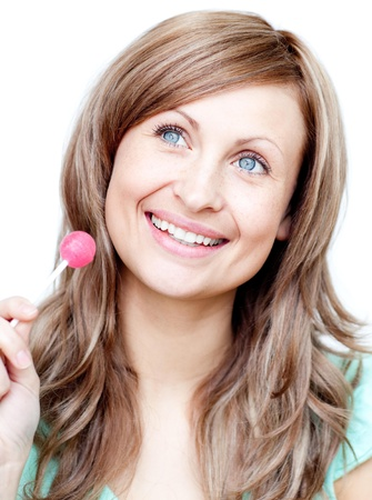 sugarplum: Delighted woman holding a lollipop  Stock Photo