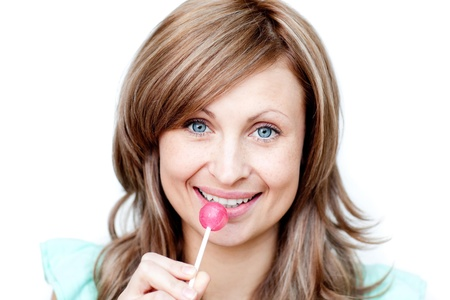 sugarplum: Attractive woman holding a lollipop  Stock Photo