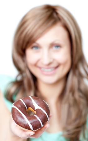 Smiling woman eating a cake Stock Photo - 10077787
