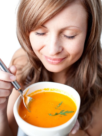 Delighted woman holding a soup bowl Stock Photo - 10113498
