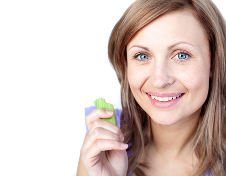 Radiant young woman eating celery  photo