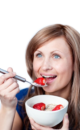 Smiling woman having a healthy breakfast Stock Photo - 10113068