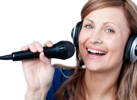 Radiant woman using a microphone Stock Photo - 10113006