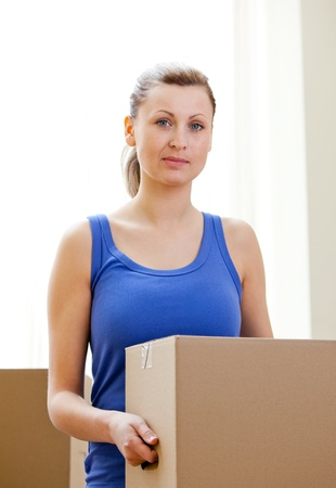gratified: Young woman having a break between boxes Stock Photo