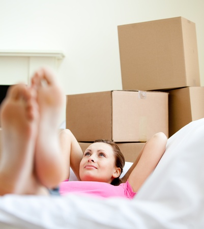 gratified: Cute woman having a break between boxes