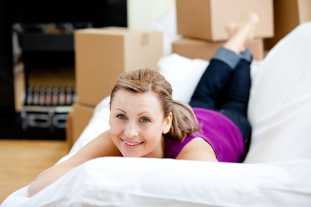gratified: Cheerful woman having a break between boxes Stock Photo