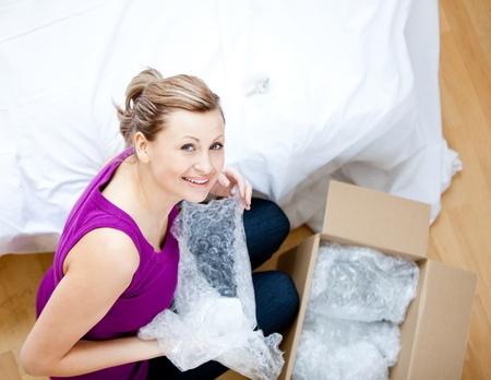 gratified: Delighted woman having a break between boxes