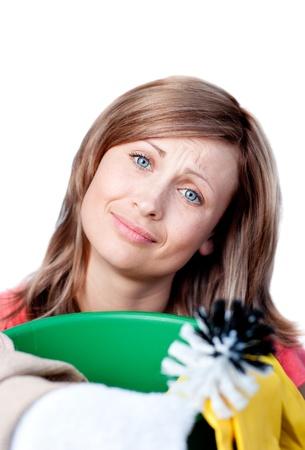 gratified: Cute woman doing housework