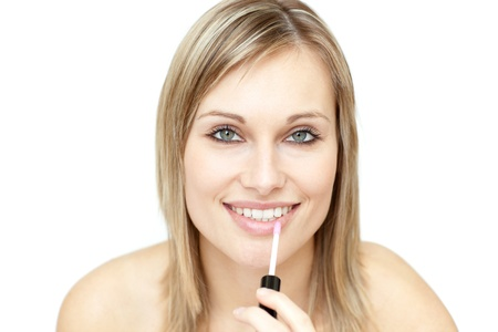 Beautiful woman putting gloss  Stock Photo - 10096528