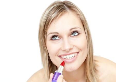 Attractive blond woman putting lipstick Stock Photo - 10096330