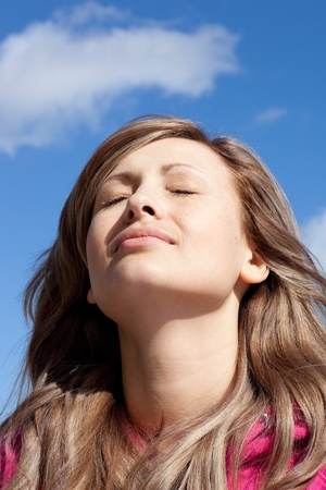 Delighted woman is relaxing outdoor  Stock Photo - 10070514