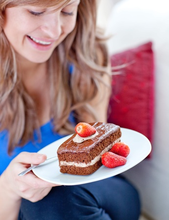 A woman holding a piece of chocolate cake Stock Photo - 10076603