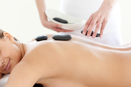 Portrait of a cute woman having a massage with stones Stock Photo - 10112819