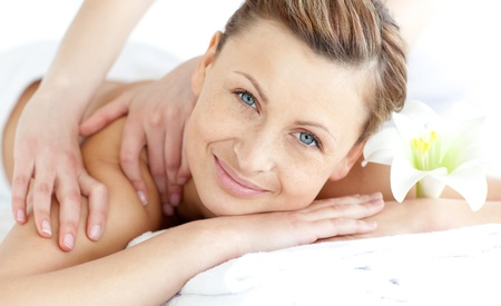 Delighted woman enjoying a back massage photo