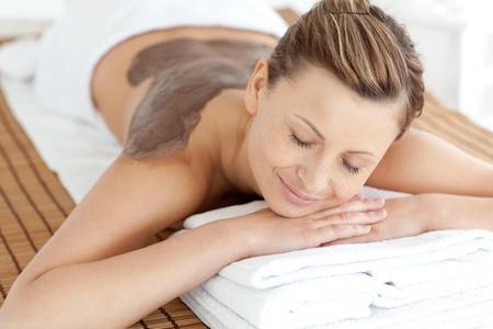 mud woman: Relaxed woman enjoying a mud skin treatment  Stock Photo