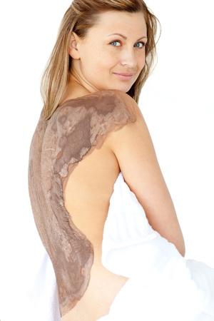 mud woman: Attractive woman enjoying a mud skin treatment  Stock Photo