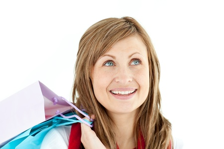 Pensive woman holding shopping bags photo