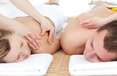 Relaxed couple receiving a back massage photo