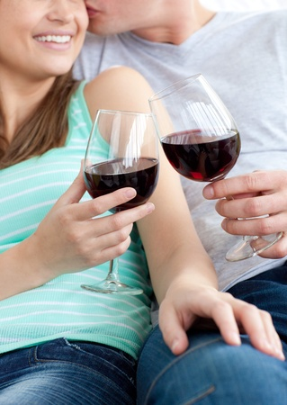 Close-up of a young couple drinking red wine photo