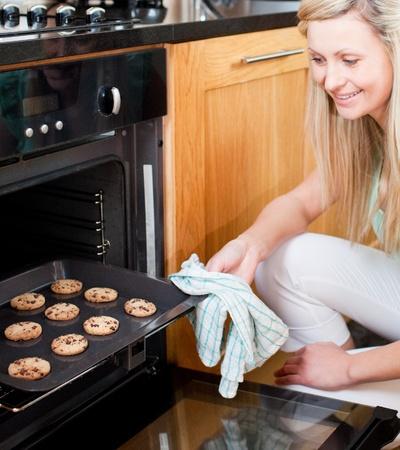 Beautiful housewife preparing cookies photo