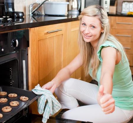Cute housewife preparing cookies photo
