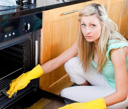 Portrait of a radiant housewife cleaning  photo