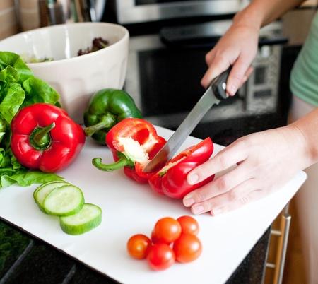 Close-up of a beautiful woman preparing a salad photo