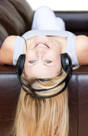 Attractive woman using headphones  Stock Photo - 10113555