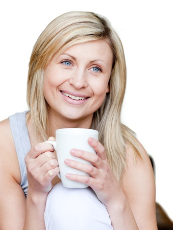 Caucasian woman holding a cup of coffee photo