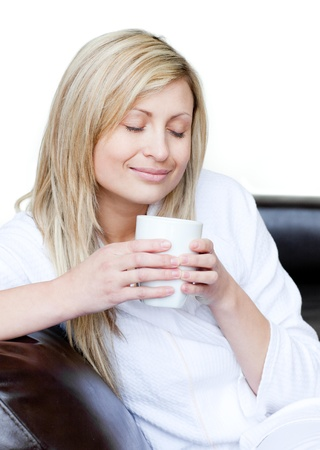 Cheerful woman holding a cup of coffee Stock Photo - 10112270