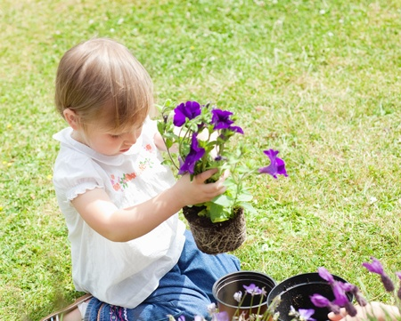 Child holding a flower photo