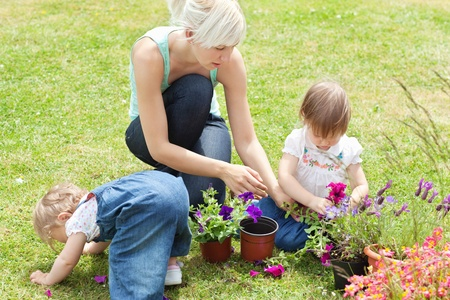 Family in the garden with flowers photo
