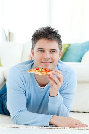 A young man holding a pizza photo