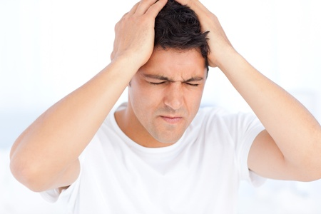 vexation: Man suffering from a migraine on waking